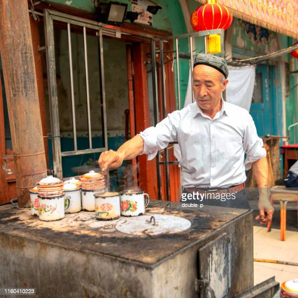 making lamb soup - kashgar stock photos and pictures