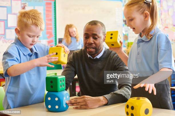making maths fun - teacher stock pictures, royalty-free photos & images