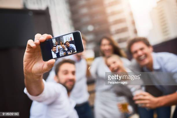 making memories after work with colleagues - selfie stock photos and pictures