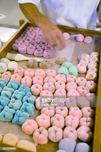 making mochi (a japanese rice dough sweet) at two ladies kitchen, hilo, east coast. - mochi stock photos and pictures