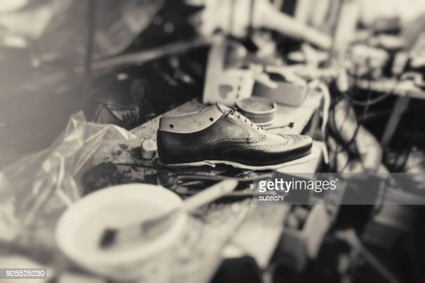 making new boots - shoemaker stock photos and pictures