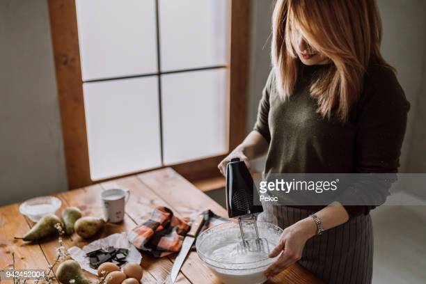 making of delicious cake cream - electric mixer stock pictures, royalty-free photos & images