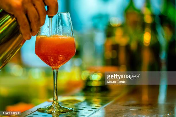 making of ice-cooled spritz with orange - mauro tandoi stock photos and pictures