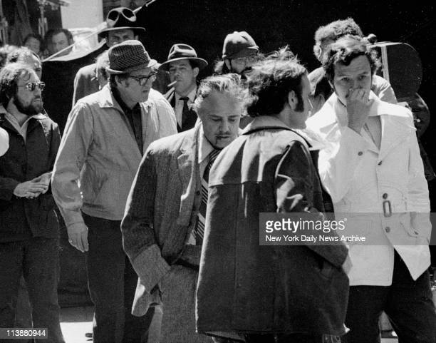 Making of movie The Godfather on Mott Street in Manhattan Simulated blood dripping from his mouth Brando is surrounded by movie people after scene in...