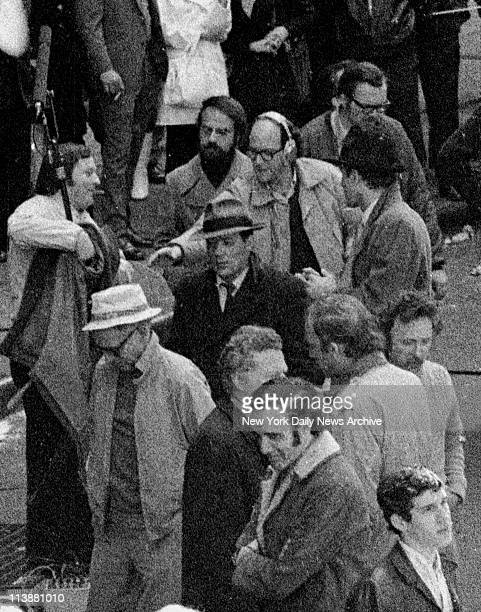 Making of movie The Godfather on Mott Street in Manhattan Sinister figure in a large fedora and long overcoat makes his way to Mott St Actor Marlon...