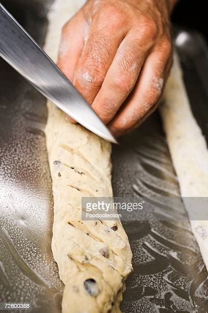 Making olive bread (scoring with a knife)