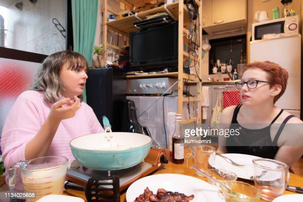 making pancake with friends - pancake day stock pictures, royalty-free photos & images