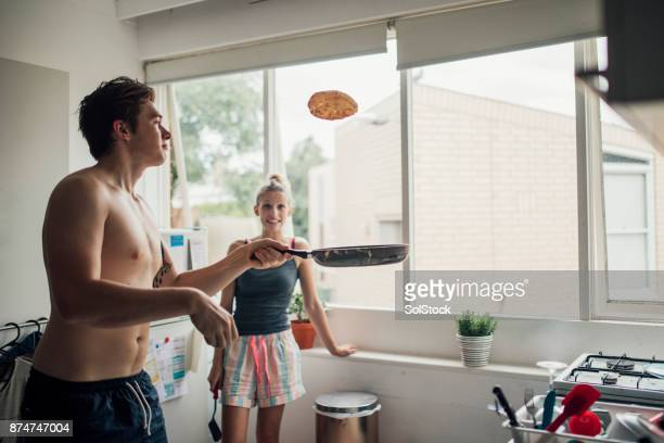 making pancakes for breakfast - pancake day stock pictures, royalty-free photos & images