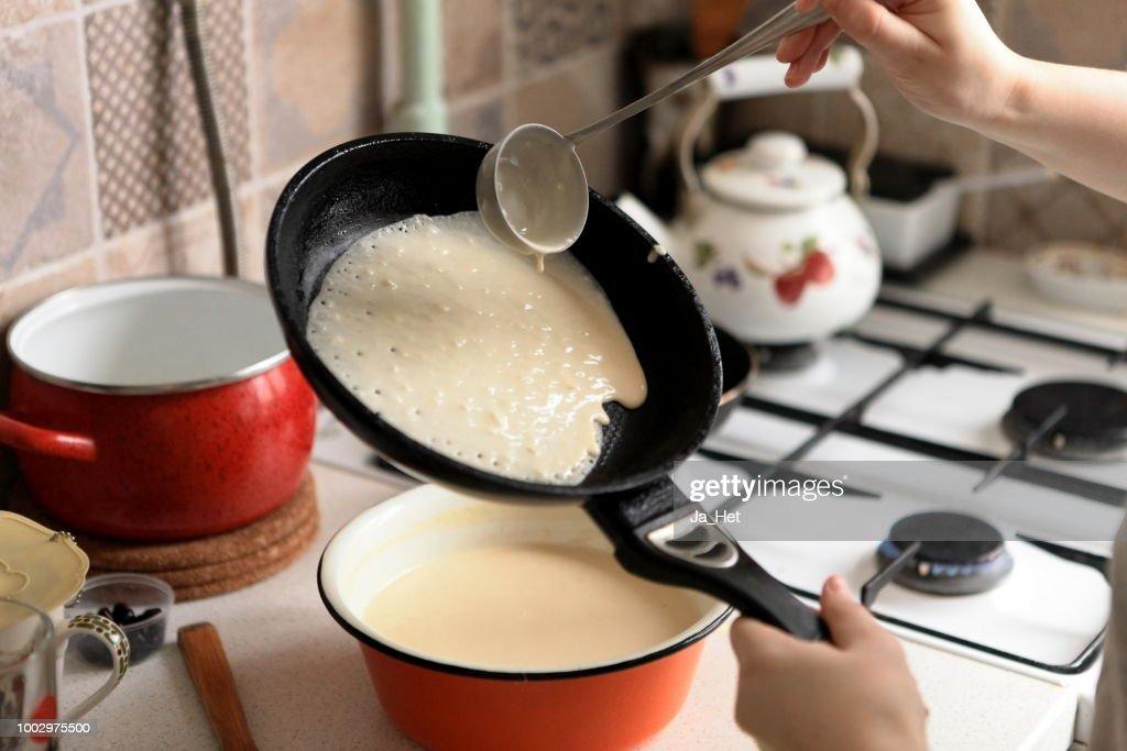 Making Pancakes on frying pan. Making Crepes on frying pan. : Stock Photo
