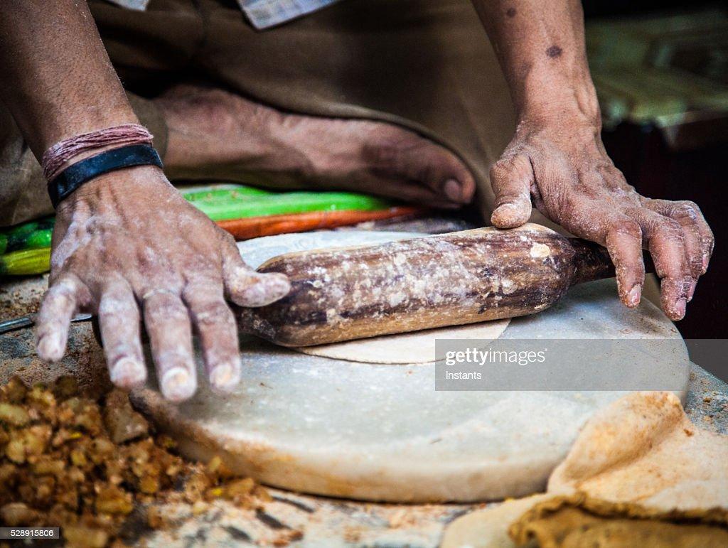 Making parathas : Stock Photo