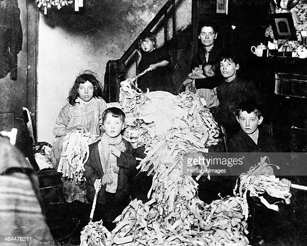 Making party streamers at home, London, c1900.