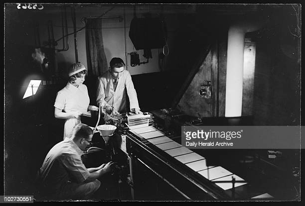 Making photographic plates 20 November 1933 A photograph of the manufacture of glass plates at the Ilford factory taken by James Jarche for the Daily...