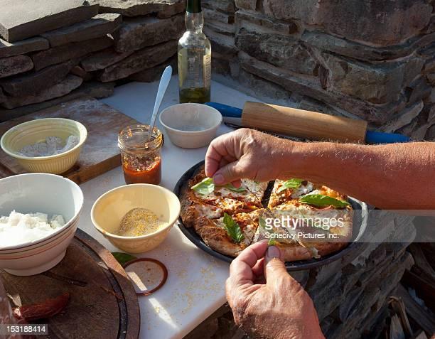 Making pizza with fresh garden grown ingredients