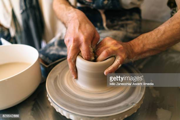 Making pottery detail