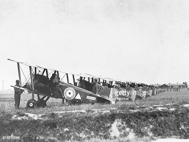 Making preparations for a daylight raid on German trenches and cities on August 6 pilots and mechanics test their planes at the 148th American Aero...