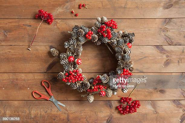 Making red Christmas wreath