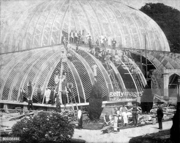Making repairs to the Great Conservatory at Chatsworth, Derbyshire, late 19th century. The great glasshouse on the Duke of Devonshire's estate at...
