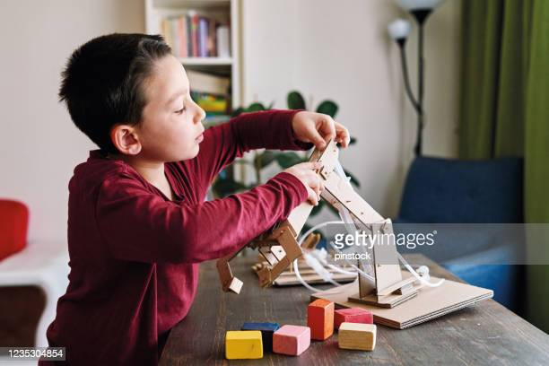 making robotic arm with cardboards. - one boy only stock pictures, royalty-free photos & images