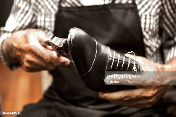 making shoes old way - leather shoe stock pictures, royalty-free photos & images