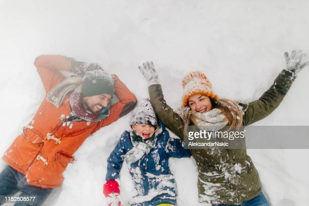 making snow angels - day stock pictures, royalty-free photos & images