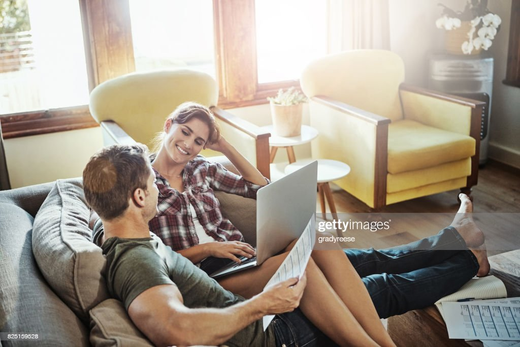 Making sofa day a productive one : Stock Photo