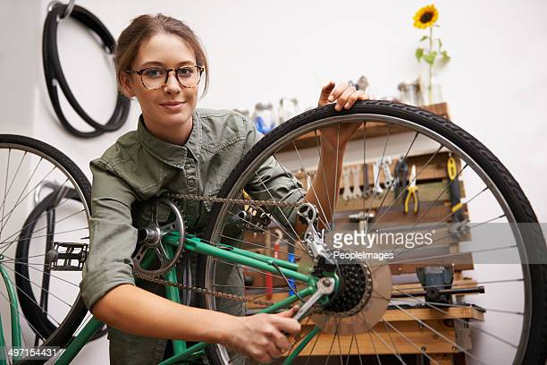 making some adjustments to her bike - tighten stock photos and pictures