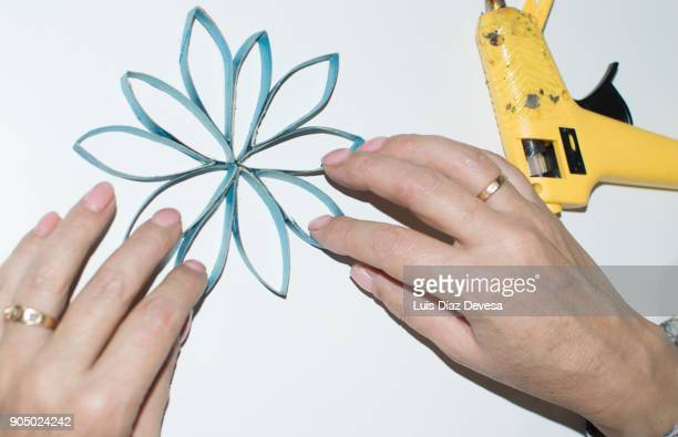 making stars with empty toilet paper roll - toilet paper tree stock pictures, royalty-free photos & images