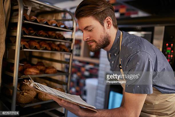 making sure everything is baked to perfection - inspector stock pictures, royalty-free photos & images