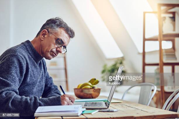making sure everything is filled in - one mature man only stock pictures, royalty-free photos & images
