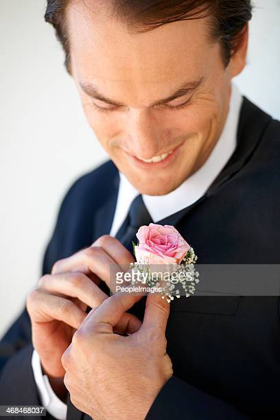 Making sure he looks perfect for the ceremony