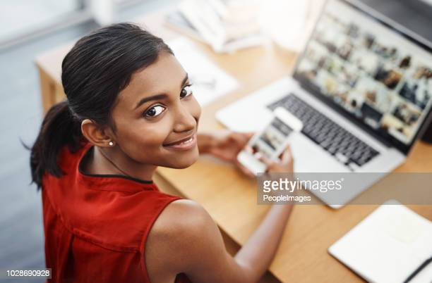 making sure her devices are synchronised - web page stock pictures, royalty-free photos & images