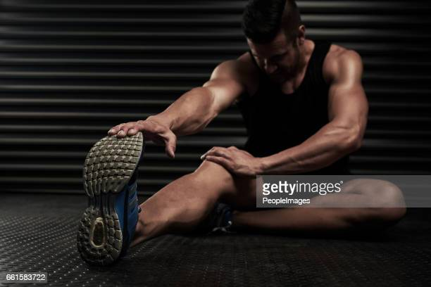 making sure his body is ready for the workout - warming up stock pictures, royalty-free photos & images