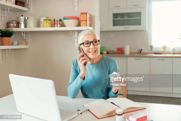 making sure she's taking the right dose - prescription medicine stock pictures, royalty-free photos & images