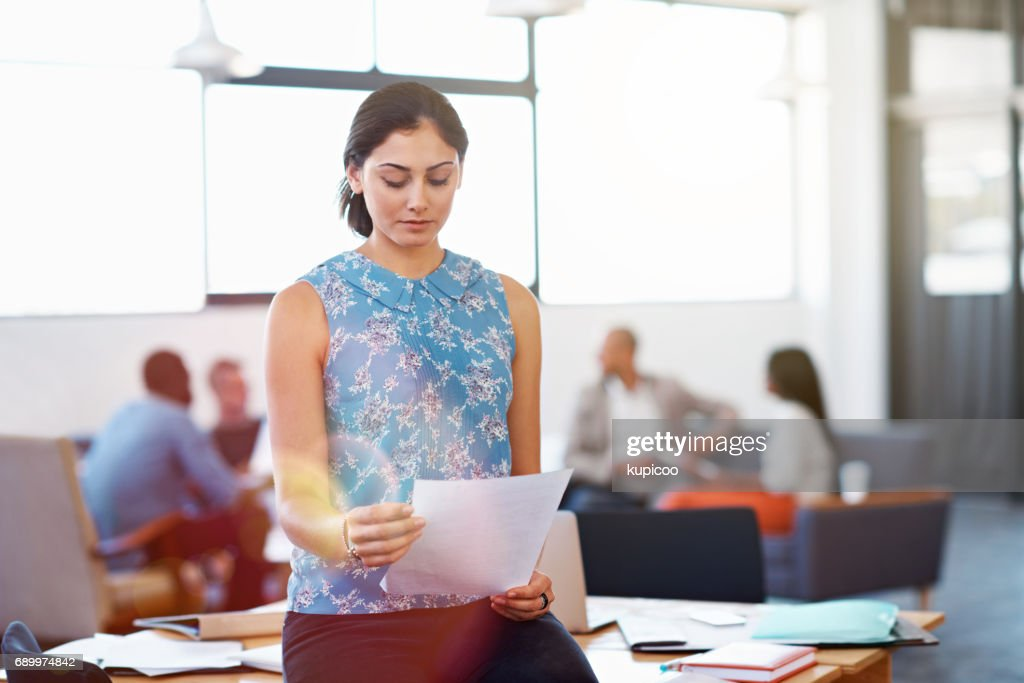 Making sure the paperwork is perfect : Stock Photo