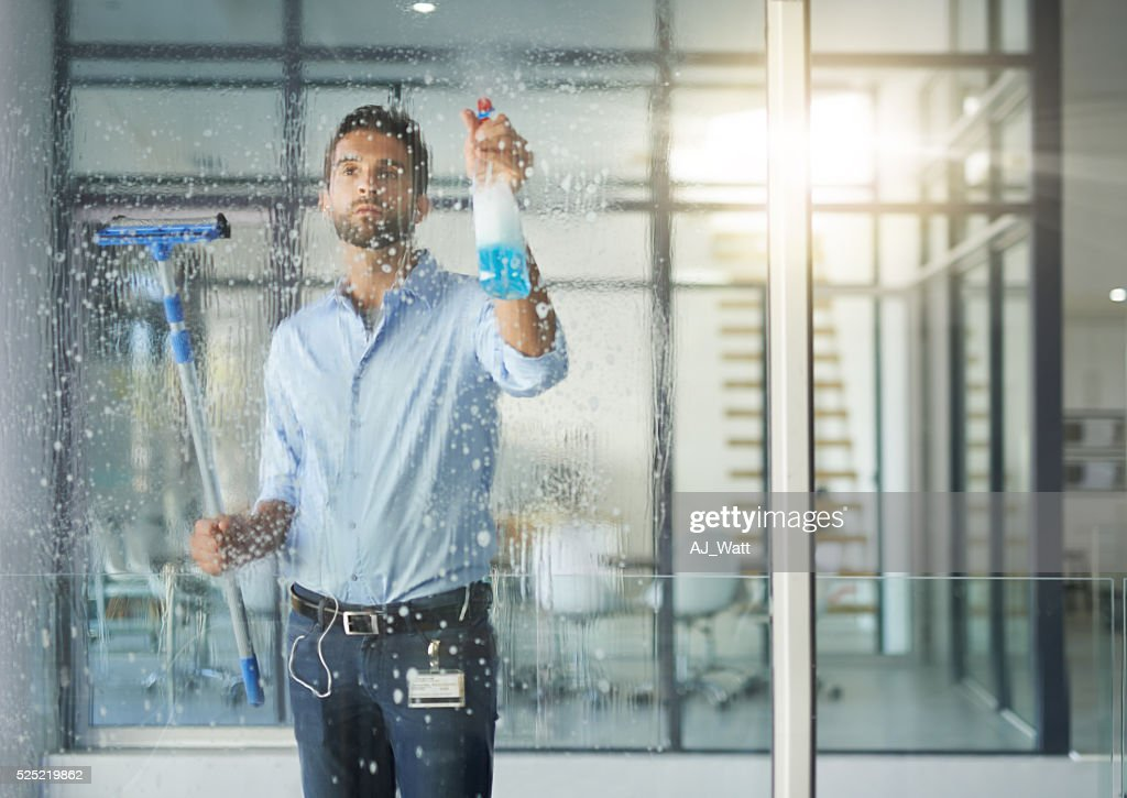 Making sure the windows are spotless : Stock Photo