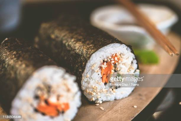 making sushi at home, hand rolls close up - nori stock pictures, royalty-free photos & images