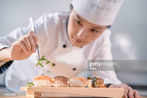 making sushi - sushi stock pictures, royalty-free photos & images