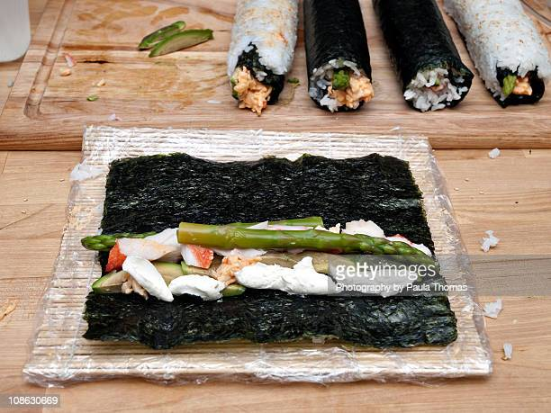 making sushi rolls - nori stock pictures, royalty-free photos & images
