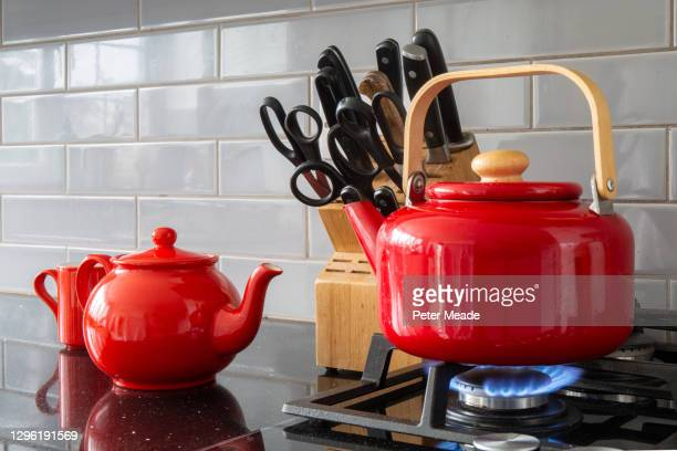 making tea - boiling the kettle - fashionable stock pictures, royalty-free photos & images