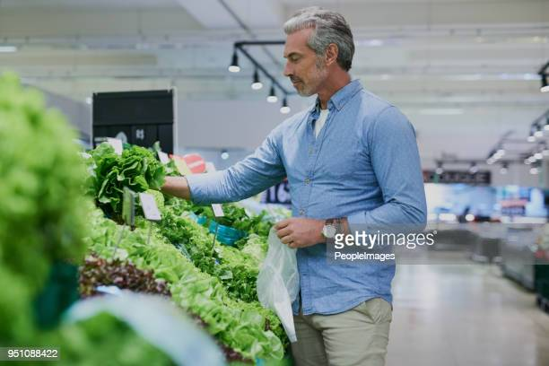 making the grocery run a healthy one - kale stock photos and pictures