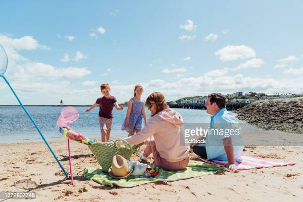 making the most of the sunshine - beach stock pictures, royalty-free photos & images