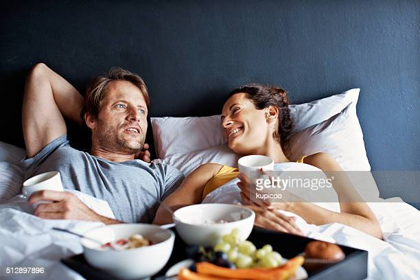 making the most of their weekend time together - breakfast in bed stock pictures, royalty-free photos & images