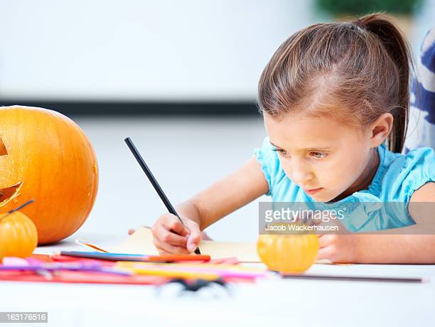 making the perfect halloween decor - colouring stock photos and pictures