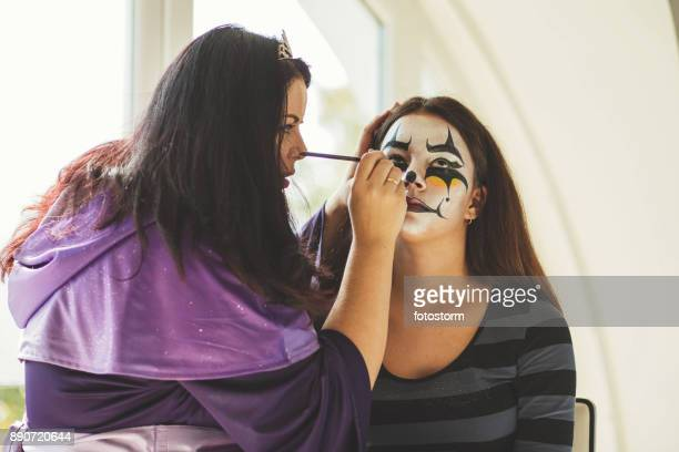 making the scary look - scary clown makeup stock photos and pictures