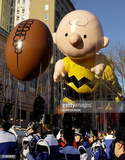 """Making their debuts, the """"Charlie Brown and the Elusive Football"""" balloons start down the route of the Macy's Thanksgiving Day Parade 28 November,..."""