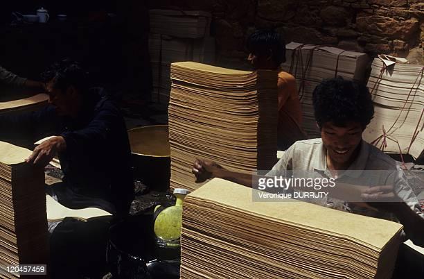 Making Tibetan prayers books, meru sarpa monastery, Lhasa, Tibet in Lhasa, China.