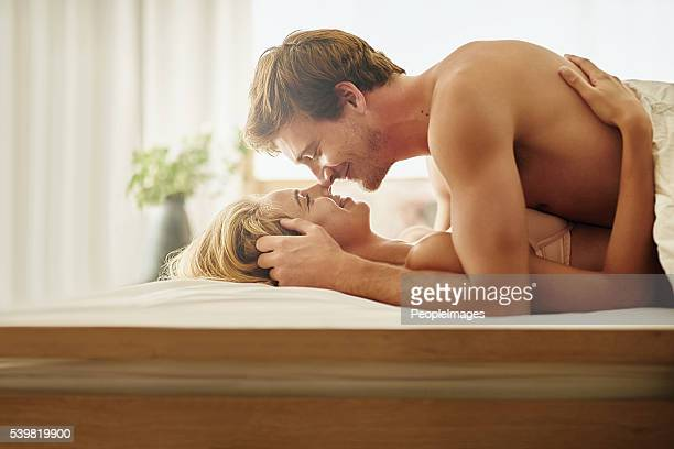 making time for intimacy in their marriage - couples making passionate love stock pictures, royalty-free photos & images