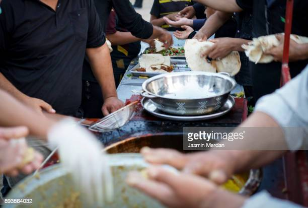 Making traditional free street food distributed to people