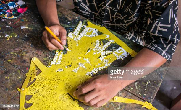 making tradititional wajang puppet on java, indonesia - shadow puppet stock photos and pictures