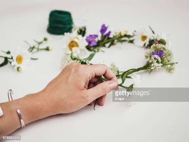 Making tying midsummer midsommar wreath